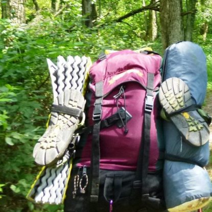 backpack with tent and sleeping pad