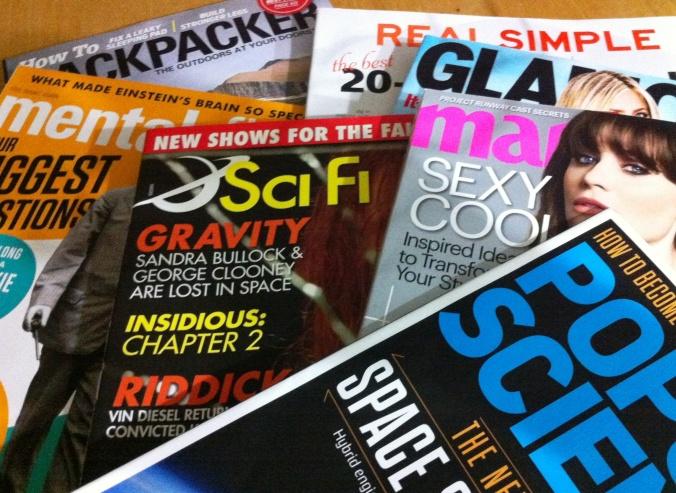 stack of glossy magazines