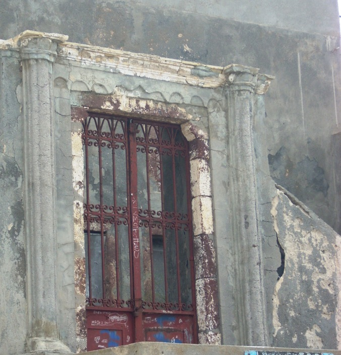 decaying red door