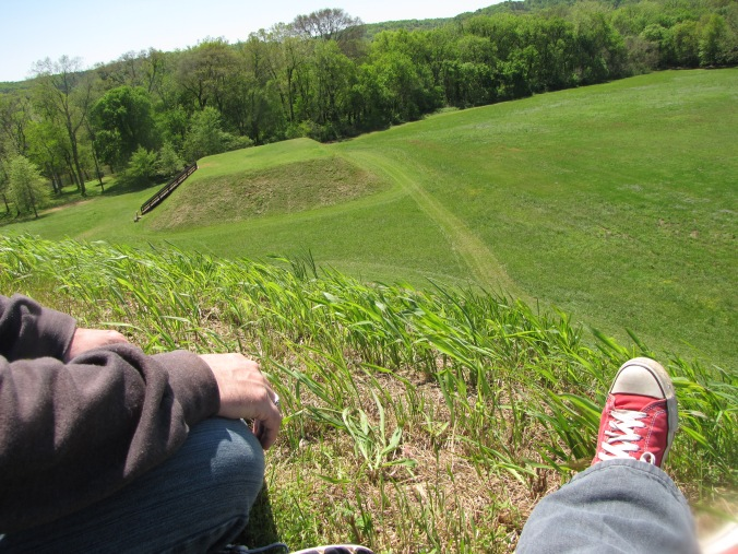 image of photographer looking down on a etowah mound